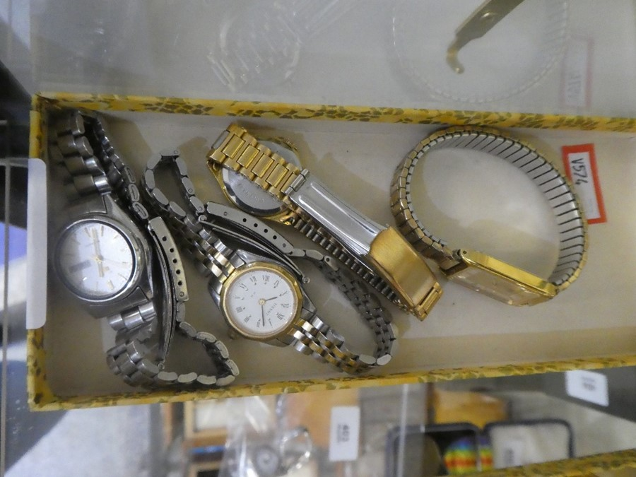A collection of 4 ladies watches including a Rotary and a Tissot watch