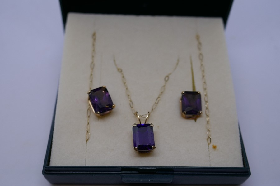 9ct yellow gold fine chain hung with a square amethyst pendant together with a pair matching earring