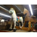 A Wooden rocking horse, vintage metal child rocking horse and wooden train