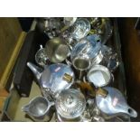 A box of silver plated ware to include tea pots, coffee pots, candelabra, etc