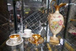 A Royal Worcester blushed ivory ewer having floral decoration and 3 miniature cups and saucers