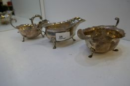 Three silver sauceboats with scalloped edge design, one being Mappin and Webb, Sheffield 1930, one B