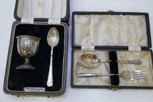 A cased silver egg cup and spoon and with a silver cased spoon and fork. 2.48 ozt approx