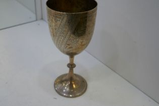 A very nice large trophy cup with engraved, decorative design of a bird, bamboo and palm tree, with