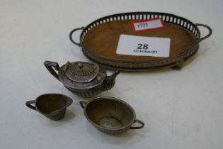An Edwardian miniature tea service comprising of a two handled silver pierced tray, on 4 ball feet w