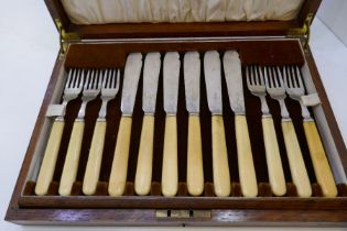A cased set of 12 silver knives and forks with bone handles AF, in a large wooden box. Hallmarked, S