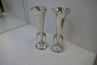 A pair of silver hammered vases in the Arts and Crafts style. Attractive items, with three handles h
