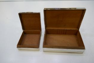 Two silver nice patterned cigarette boxes, one larger hallmarked London 1947, possibly Padgett and B