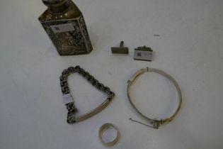 A nice lot comprising a silver bangle hallmarked London 1976, Fred Manshaw Ltd, a silver ring Birmin