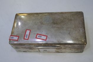 A large cigarette box with engraved message and a cartouche with Si Vis Pacem Para Bellum, meaning i