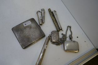 A lot comprising a silver Chatelaine with a silver cheroot holder with gold top
