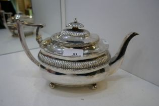 A very nice Georgian large silver teapot with gadrooned decoration and knop, on four ball feet. Hall