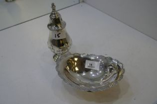 A silver decorative sugar sifter on a raised pedestal foot. Birmingham 1938, Adie Brothers Ltd. Also