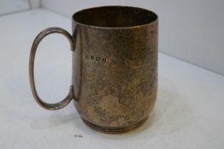 An Edwardian silver very heavy tankard hallmarked Birmingham 1906, George Nathan and Ridley Hayes. W