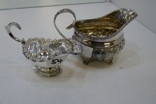 A very decorative Georgian silver gilt boat, with floriated repoussed pattern on low relief with cen