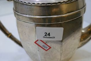 A nice, large silver teapot of canted oval style with slight hammered rim. Hallmarked Chester 1921,