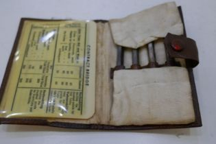 A very nice leather wallet of a garne with four silver pencils, marked 935 Germany with cards