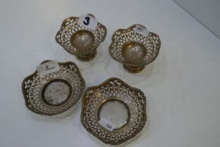 Two silver pedestal nut dishes of pierced design with beaded rim, along with a pair of matching bon