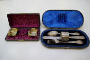 A gorgeous cased set of floriated engraved silver knife, fork, spoon and napkin ring. Very decorativ