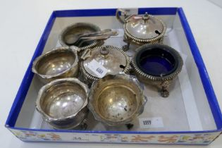 A selection of three silver salts by Asprey and Co Ltd, with lion feet and gadrooned rim. Also with