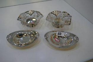 A pair of high quality, decorative silver bon bon dishes of pierced design on a raised pedestal foot