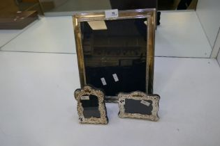 Three silver photoframes to include two small ornate frames,14cm x 9cm approx and 11cm x 12cm approx