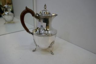 A silver Victorian small hot water jug on three pretty feet and wooden handle. Nice handle. Hallmark