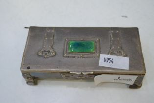 A very decorative and ornate silver trinket box with a pretty decoration and green stone. Hallmarked