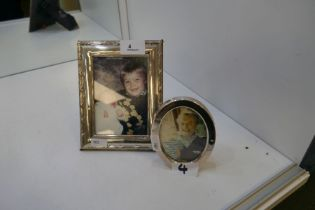 Two silver photo frames. One rectangular with decorative border hallmarked London 1990, RBB 17cm x 1