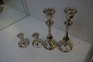 Two pairs of silver candlesticks, small pair hallmarked Birmingham 1968 JP. 8cm high approx. Larger