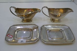 A pair of very heavy silver sauce boats and trays. Hallmarked Birmingham 1934. Alexander Clark and C