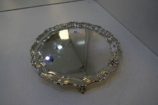 A heavy silver tray with scalloped edges on four claw feet. Sheffield 1928 James Dixon and Sons Ltd,