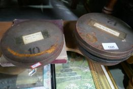 Five old movie reels and a quantity of pictures