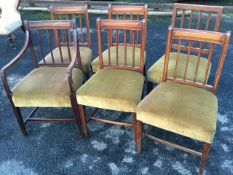 A married set of six nineteenth century dining chairs, all with moulded spindles to backs above