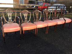 A set of six nineteenth century Hepplewhite style mahogany dining chairs with two carvers, the