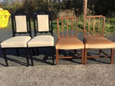 A pair of antique elm dining chairs with lathe backs above stuffover upholstered seats, raised on