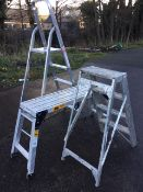 A small set of folding aluminium steps with three ribbed treads; a folding aluminium trestle with