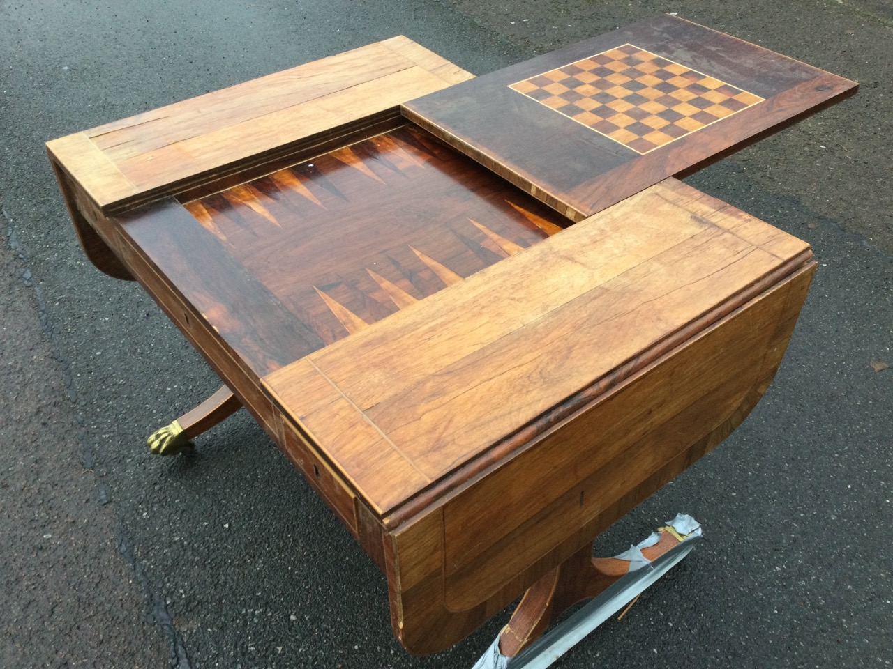 A walnut sofa games table, the rectangular rosewood crossbanded top with drop leaves having - Image 3 of 3