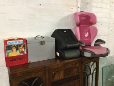 A Graco childs car seat; a pair of Halfords booster seat supports; a metal filing cabinet; and a box
