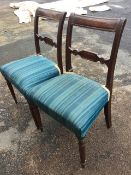 A pair of nineteenth century mahogany chairs with tablet panelled back rails on ribbed stiles, the