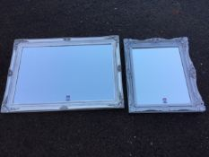 Two silver painted mirrors in foliate gesso moulded frames. (2)