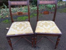 A near pair of nineteenth century mahogany dining chairs with tablet back rails framed by fluted