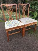 A pair of chippendale style mahogany dining chairs with shaped back rails above pierced splats,