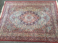 A floral Wilton style wool carpet woven in an orientalist Kashan paisley design having field with