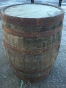 An old oak whiskey barrel, the staves bound by six riveted metal strap bands. (35in)