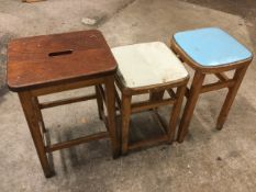 A rectangular hardwood stool on dowel jointed square moulded legs joined by rectangular