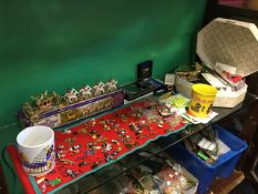 A boxed diecast royal state coach; a collection of enamelled golly brooches; and other golly stuff