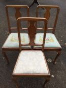 A set of three mahogany bedroom chairs with vase shaped splats above floral needlework drop-in