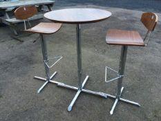 An Italian walnut & chrome pedestal table & two chairs, the circular table on column, the adjustable