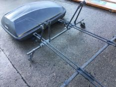 A Halfords rectangular car roofbox on Thule rails; and a Halfords adjustable car roof rack. (2)